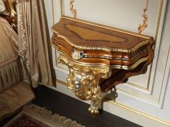 Carved bedside table for classic double bedroom