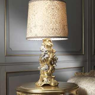 Classic lamp in gold leaf in baroque style