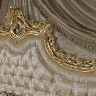 Bed with baroque headboard