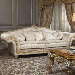 Classic three seater sofa, golden and carved details and cymatium, fabric finish. Carved table, golden and silver leaf finish