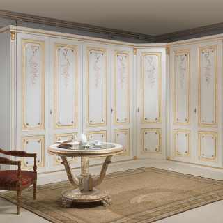 Classic modular wardrobe with corner element. White and gold finish, carved pillars, ochre bands
