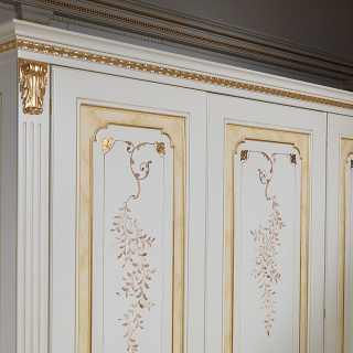 Modular classic wardrobe withe and gold finish. Flower decorations, carved and golden pillars, golden details