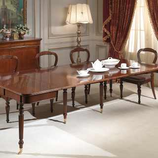 Classic walnut console-table extensible till cm 260 with 4 extensions, with wheels. Here fully extended