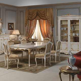 Luigi XV style dining room: carved table and chairs, sideboard with big carved mirror and glass showcase. All lacquered and gold finish, Venezia classic furniture collection