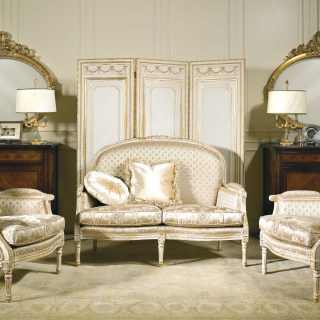 Classic living room Rialto collection, ivory fabric finish, carved details, white over gold finish. Carved screen and mirror