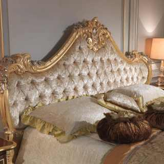 Bed with capitonné headboard and luxury handmade carvings, gold and silver leaf