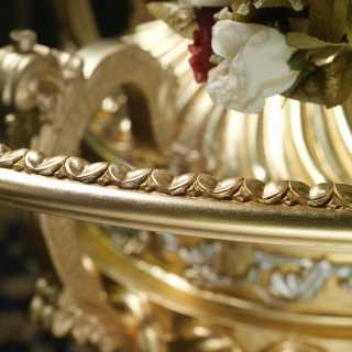 Luxury carved table with golden base
