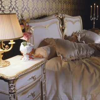 Classic bedroom Luigi XVI style: carved bed and night tables, white over gold finish