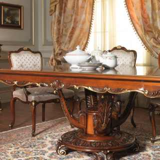 Carved table and upholstered and carved chairs Luigi XV style, Parigi collection. All walnut and gold finish