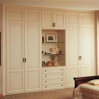 Varnished modular wardrobes, classic style, composed by double two doors elements and column item with open compartment, drawers base. Handmade in Italy