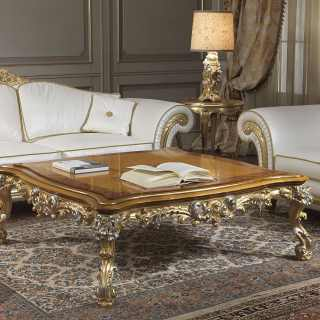 Classic living room Imperial with carved sofa and armchair, carved and golden details, white leather finish. Carved table, gold and silver finish