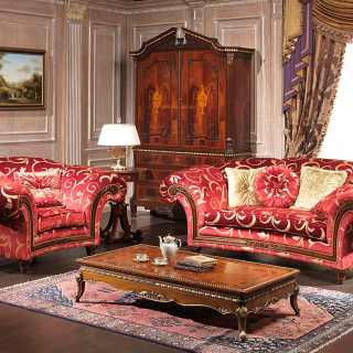 Classic living room Palace, red and gold fabric finish, composed by sofa and armchair with carved walnut details and a carved and inlayed table