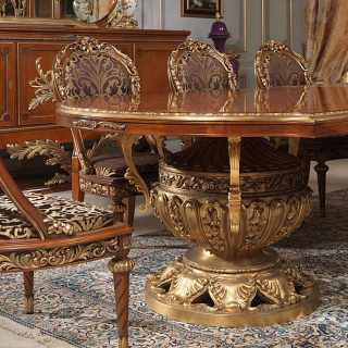 Classic luxury furniture Versailles collection, Luigi XVI style: myrtle briar table with rich golden carvings, carved and upholstered chairs. All walnut and gold leaf finish