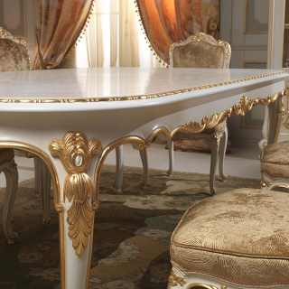 Luigi XV style dining room, Venezia classic collection: carved table, lacquered and gold finish. Detail of a carving