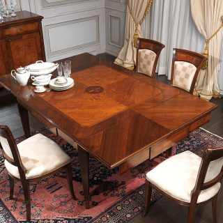 Classic extensible table Maggiolini style, walnut and olivewood finish with handmade marquetry. Inlayed chairs and sideboard. Classic italian furniture