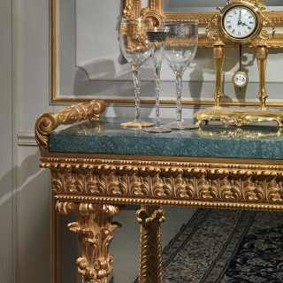 Carved console with green Guatemala marble top, carved columns golden finish. Made in Italy