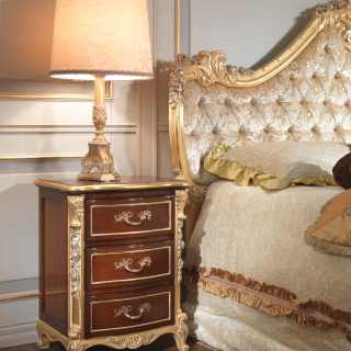Cherrywood night table with rich gold and silver leaf carving and
