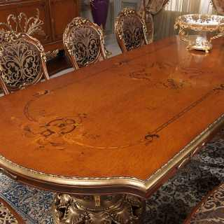 Luigi XVI style table made with myrtle briar, rich carvings and marquetry. Luigi XVI style chairs. All Versailles classic luxury collection