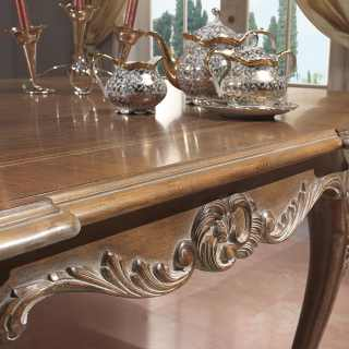 Detail of the handmade carvings for the Luigi XV style table, walnut decapé finish. Parigi classic luxury furniture collection
