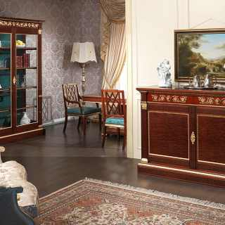 Ermitage living room, impero style. Mahogany glass showcase and sideboard with brass decorations and gold leaf details. Mahogany and gold leaf table