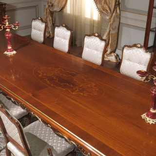 Carved and inlayed ractangular table, walnut decapé finish; upholstered and carved chairs, Luigi XV style, Parigi collection