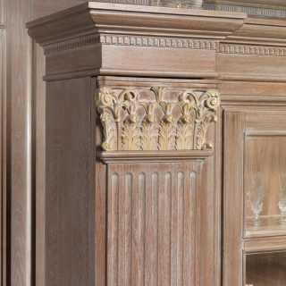 Classic bookcase unit for modular wall, detail of a column with carved and golden capital
