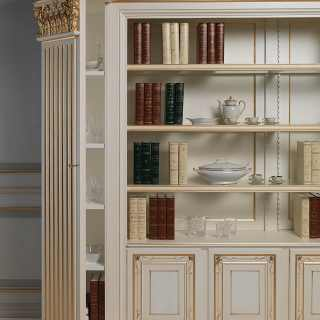 Classic bookcase, ivory lacquered finish with carvings and gold decorations. Hidden shelves on the columns