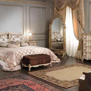 Classic bedroom Luigi XVI style: carved bed and upholstered capitonné bench, chest of drawers, night tables, mirror. Handmade carvings.