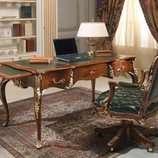 Classic luxury studio Luigi XV style: carved desk, walnut antique finish and gold details; Luigi XV style armchair