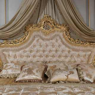 Bed with capitonné headboard and golden carvings