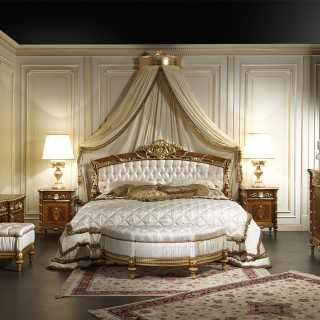 Furniture for bedroom in walnut of the Louis XVI collection Noce e Intarsi: bed in walnut and golden carvings, chest of drawers, night tables and toilette in walnut