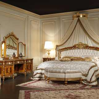 Double bed in walnut with gold leaf carvings mada by hand. Night tables and toilette in inlaid and carved walnut