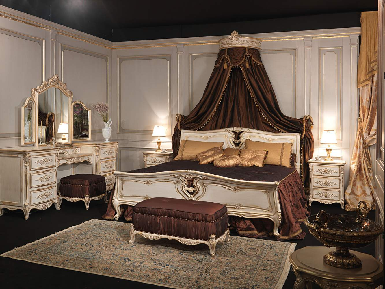 Classic Louis XVI bedroom, bed in carved wood with wall baldaquin, night table and dressing table with mirror, upholstered bench and pouf