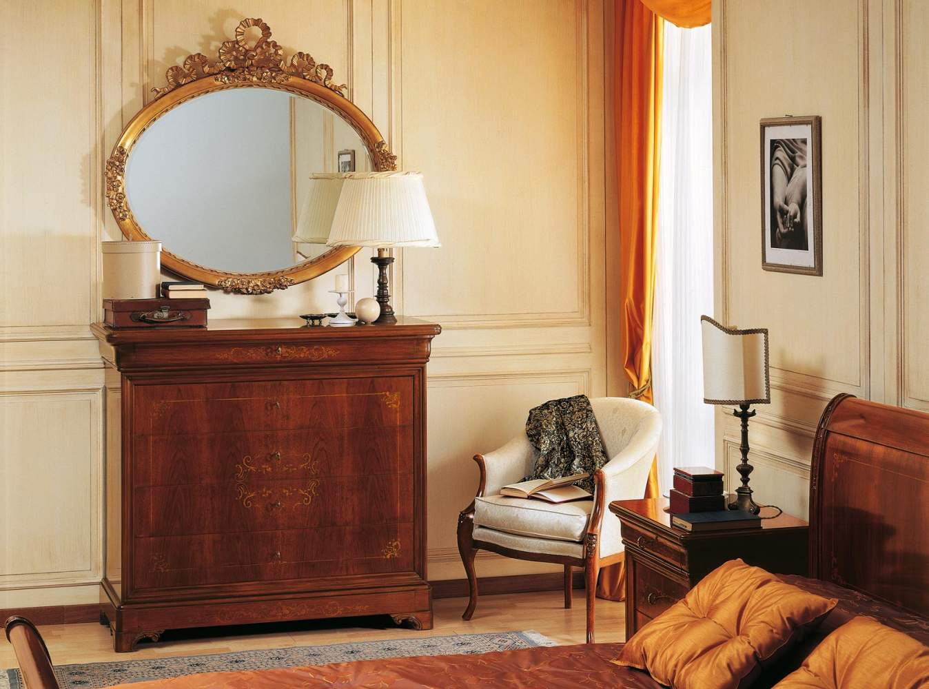 19th century french bedroom, inlaid chest of drawers and golden mirror