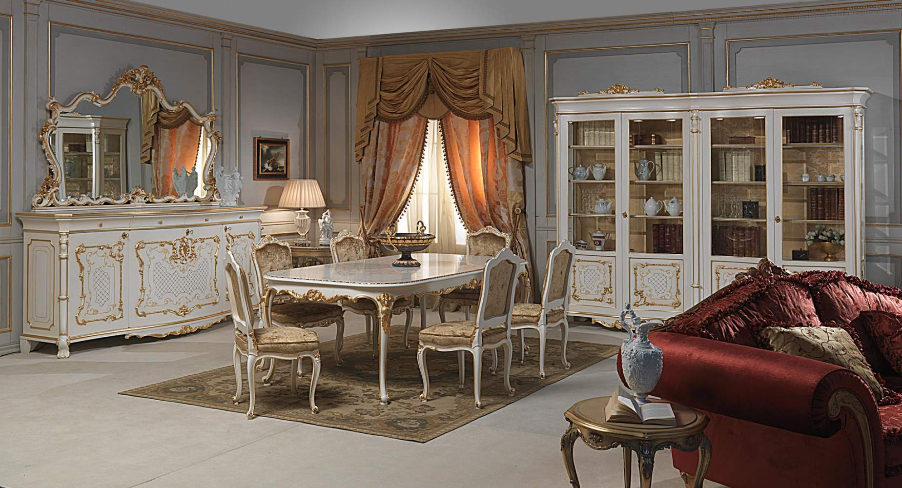 Dining room in Louis XV style: table and carved chairs, sideboard with ...