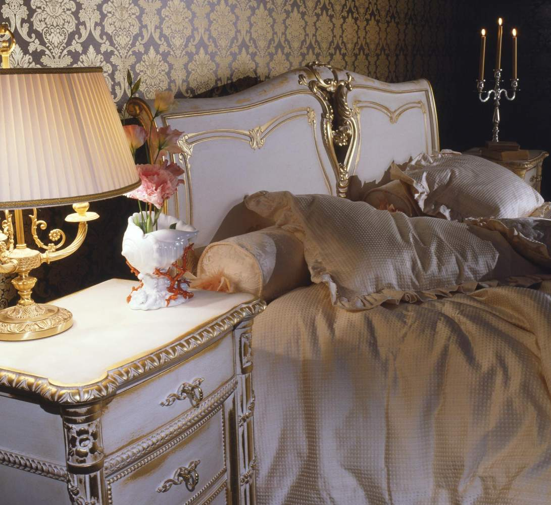 Classic Louis XVI bedroom, bed and night table in carved wood with finishings in white over gold