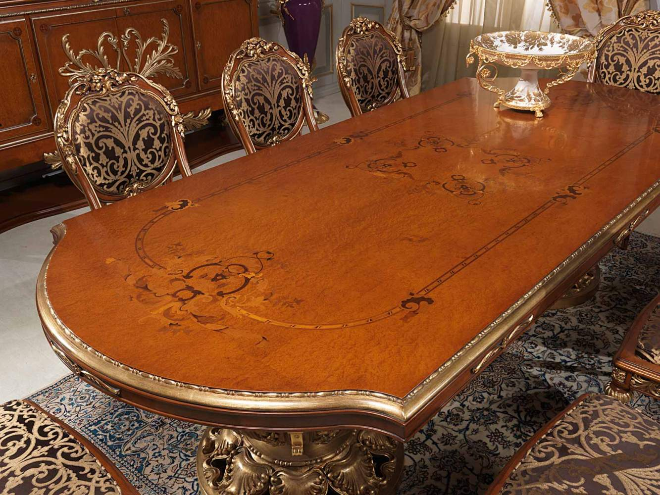 Carved and inlaid table in Louis XVI style