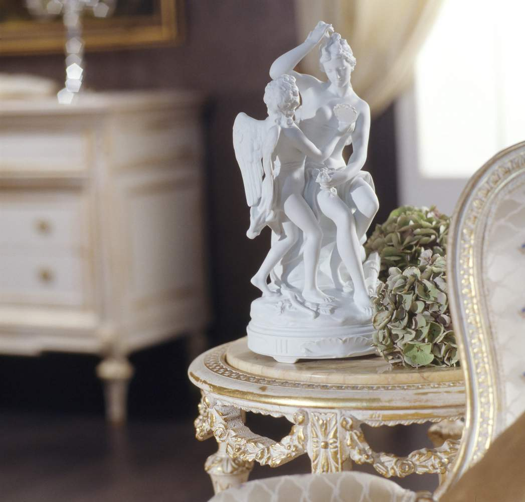 Classic Louis XVI bedroom, small round carved wood table and marble